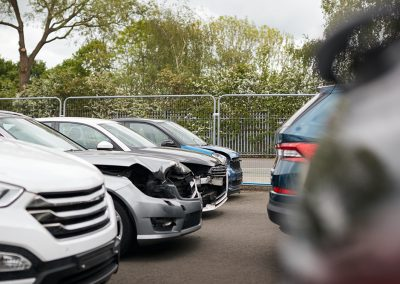 Cars Damaged In Motor Vehicle Accidents Parked In Garage Repair Shop